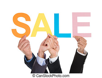 Hands Holding Letters Building The Word Sale
