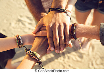 Close up of hands holding together
