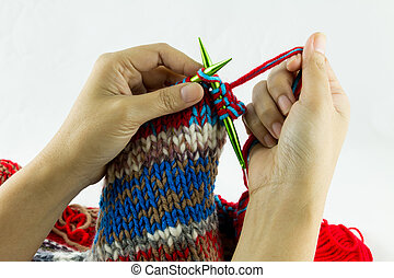 Close-up of hands knitting