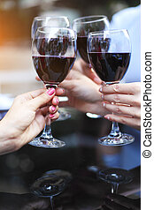 Close up of hands of a friends toasting