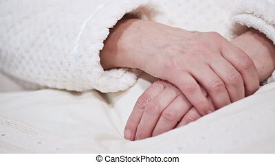 Close up of Hands of an old woman folded one over the other. Elderly woman with folded hands.