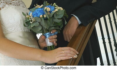 Close-up of hands of bride and groom outdoors