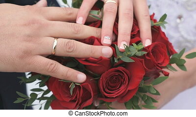 Close-up of hands of newlyweds