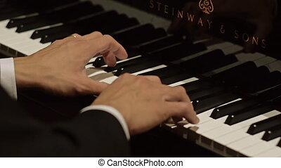 Close-up of hands play piano