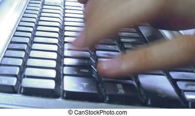 close-up of hands typing keyboard