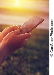 Close up of hands typing message on mobile phone
