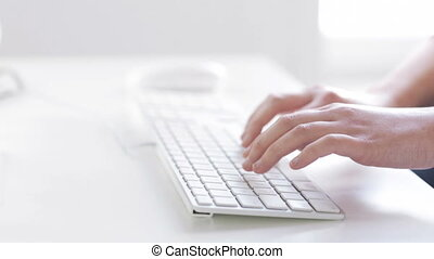 close up of hands typing on computer keyboard - business,...