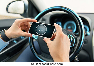 close up of hands with music icon on smartphone - transport,...