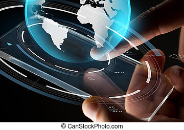 close up of hands with smartphone and earth