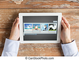 close up of hands with video gallery on tablet pc - people,...