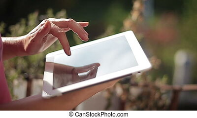 Close up of hands woman using her tablet