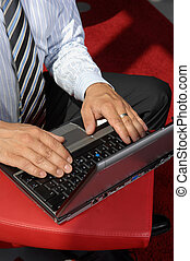 Close-Up Of Hands Working On Laptop