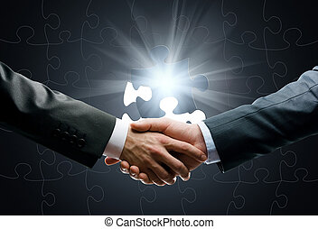 Close up of handshake against world connection background -...