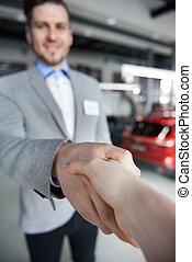 Close up of handshake in the showroom