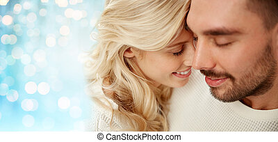 close up of happy couple faces with closed eyes - family,...