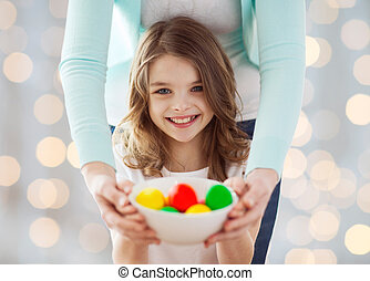close up of happy family holding easter eggs - easter,...