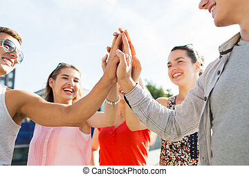 close up of happy friends making high five gesture - success...