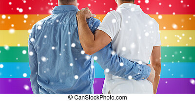 close up of happy male gay couple hugging