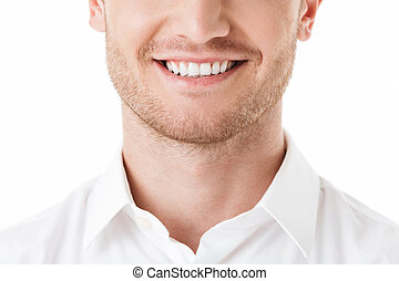Close up of happy man's toothy smile isolated over white...