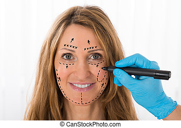 Woman With Perforation Lines Marked On Face - Close-up Of...