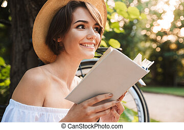Close up of happy young girl reading a book