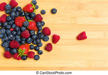 Close up of heap of berries on the table, isolated on white....