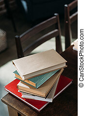 close up of heap of books on wooden tabletop with copy space