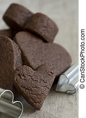 Close Up of Heart Cookie Cutters and Cookies - Selective...