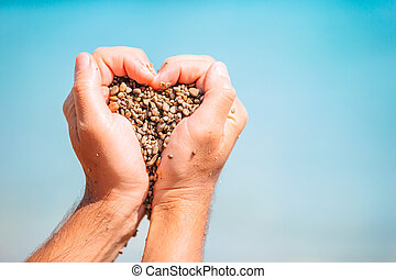 Close up of heart made by male hands background the ...