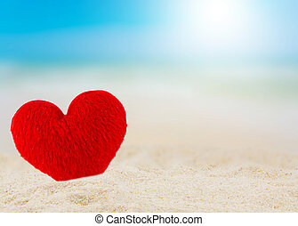Close up of heart on the beach in beautiful.