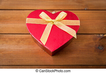 close up of heart shaped gift box on wood