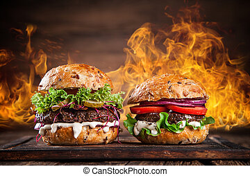 Close-up of home made burgers with fire flames
