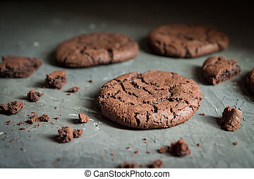 Close up of homemade chocolate cookie on gray concrete background. Selective focus. Shallow depth of field