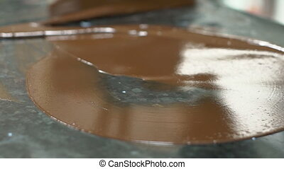Close up of hot chocolate is being deleted from kitchen...