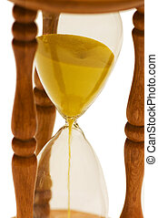 Close up of hourglass isolated on the white