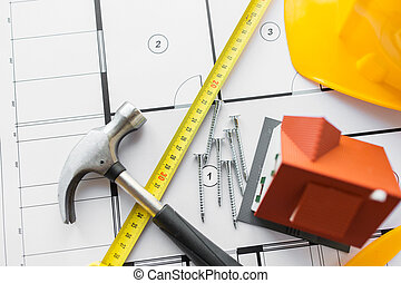 close up of house blueprint with building tools