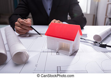 Close-up Of House Model On Blueprint