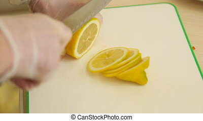 Close up of human cutting lemon