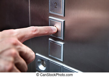 Human Finger Pressing Elevator Button - Close-up Of Human...