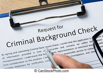 Hand Filling Criminal Background Check Application Form
