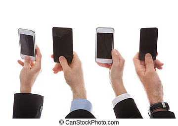 Close Up Of Human Hand Holding Cell Phone