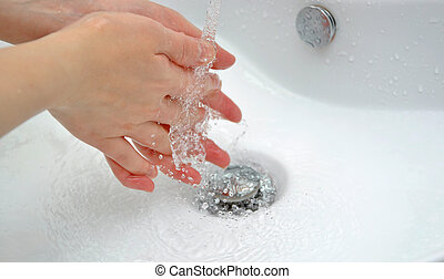 Close-up of human hands being wash