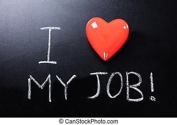 Close-up Of I Love My Job Text Written On Blackboard