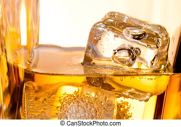 close-up of ice cubes in the whiskey