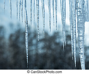 Close-Up Of Icicles On Railing.
