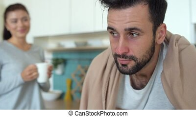 Close up of ill man feeling relief after wife help -...
