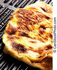 close up of indian fried flour pancake