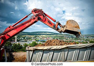 close-up of industrial excavator loading a dumper truck