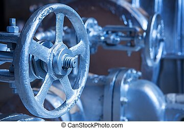 Close-up of industrial gate valve with focus on stem and nut...