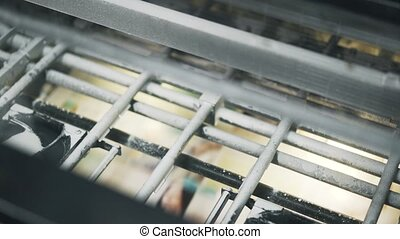 Close up of industrial printer making advertisement posters